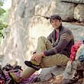 A Young Rock Climber Puts On A Climbing by Matthew Wakem
