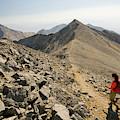 A Young Woman Hikes Borah Peak by Jeff Diener
