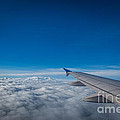 Above The Clouds  by Michael Ver Sprill