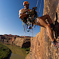 Adventure Racer Rappelling Over A River by Corey Rich