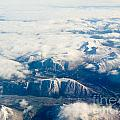 Aerial View Of Snowcapped Mountains In Bc Canada by Stephan Pietzko