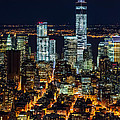 Aerial View Of The Lower Manhattan Skyscrapers By Night by Mihai Andritoiu
