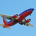 Airliner Landing At Sky Harbor Phoenix Arizona by Tom Janca