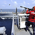 Airman Fires A Shot Line From Uss by Stocktrek Images