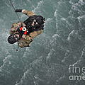 Airmen Are Hoisted Out Of The Water by Stocktrek Images