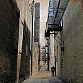 Alley With Guy Reading And Grunge Border by Anita Burgermeister