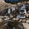 Alluvial Wet Rocks by Josh Baker