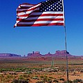 American Flag In Monument Valley by Dany Lison