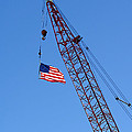 American Flag On Construction Crane by Olivier Le Queinec