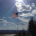 American Flag Waving In The Sunrays by Shawn Hughes