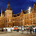 Amsterdam Central Station And Tram Stop At Night by Artur Bogacki