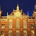 Amsterdam Central Train Station At Night by Artur Bogacki