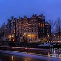 Amsterdam Corner Cafe With Light Trails by Ann Garrett
