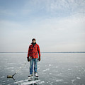 An Adult Male Playing Ice Hockey Poses by David Nevala