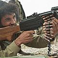 An Afghan Local Police Officer Fires by Stocktrek Images