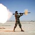 An Afghan National Army Soldier Fires by Stocktrek Images