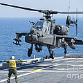 An Army Ah-64d Apache Helicopter by Stocktrek Images