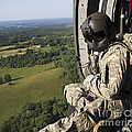 An Army Crew Chief Looks Out The Door by Stocktrek Images