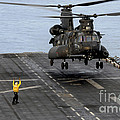 An Army Mh-47g Chinook Conducts Deck by Stocktrek Images