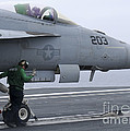 An Aviation Boatswains Mate Prepares An by Stocktrek Images