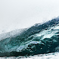 An Empty Wave Breaks Over A Shallow Reef by Sergio Villalba