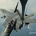 An F-15e Strike Eagle Receives Fuel by Stocktrek Images