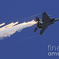 An F-15e Strike Eagle Releases Flares by Remo Guidi