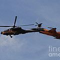 An F-16 Falcon And Ah-64 Apache by Ofer Zidon