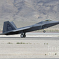 An F-22 Raptor Landing On The Runway by Remo Guidi