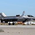 An F-35b Lightning II Landing At Marine by Riccardo Niccoli