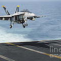 An Fa-18f Super Hornet Prepares To Land by Stocktrek Images
