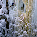 An Ice Climber Ascends A Frozen by Randy Barnes
