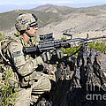 An Infantryman Provides Overwatch by Stocktrek Images