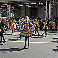 An Irish Dance Group Flying High While Dancing At The 2009 St. Patrick Day Parade by James Connor