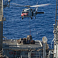 An Mh-60s Sea Hawk Delivers Supplies by Stocktrek Images
