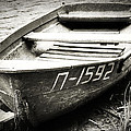 An Old Row Boat In Black And White by Emily Kay