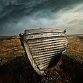 An Old Wreck On The Field. Dramatic Sky In The Background by Jaroslaw Blaminsky