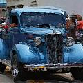 Antique Chevy Truck In Parade by George Ferrell