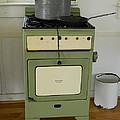 Antique Green Stove And Pressure Cooker by George Pedro