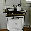 Antique Stove Number 3 by George Pedro
