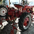 Antique Tractor Hiding In The Shadows by George Pedro