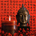 Asian Candle With Red Orential Background by Sandra Cunningham