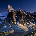 Assiniboine And Sunburst Peak At Sunset by Richard Berry