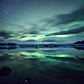 Aurora Borealis Over Lake by Matteo Colombo