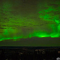 Aurora Flare With Clouds by Joan Wallner