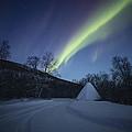 Aurora On A Blue Night Sky by Pekka Sammallahti