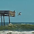 Avon Pier Surfers Leap 2 1/19 by Mark Lemmon