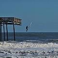 Avon Pier Surfers Leap 3 1/19 by Mark Lemmon
