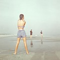 Back View Of Three People At A Beach by Serge Balkin