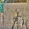 Banksy In Bethlehem 2 by David Birchall